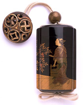 Inro - a small lacquered container hung from the waist, generally used to hold seals or medicines